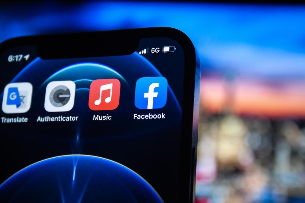 black smartphone showing 9 00