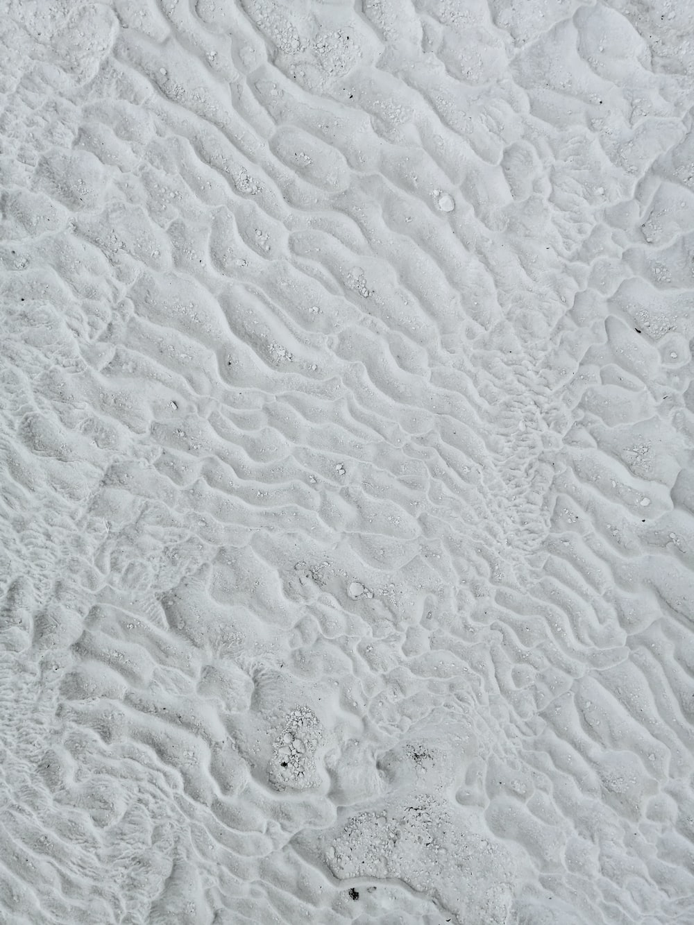 white sand with water droplets