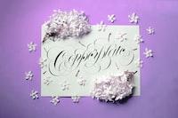 happy birthday greeting card on purple surface