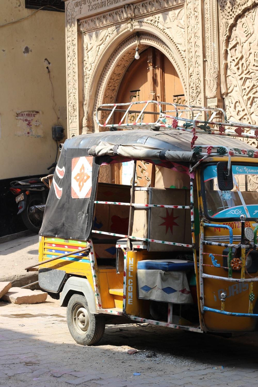 blue and yellow auto rickshaw