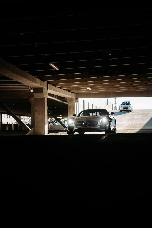 black sedan parked on parking lot