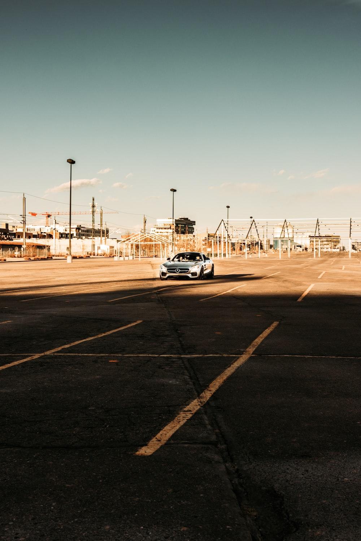 white suv on gray asphalt road during daytime