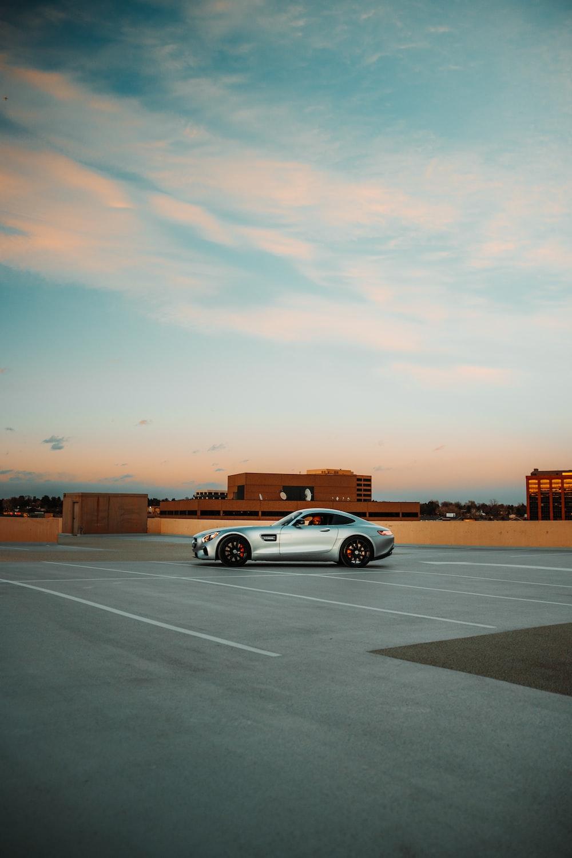 white sedan on gray asphalt road during sunset