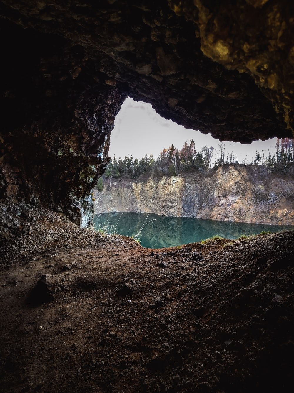 water falls in cave during daytime