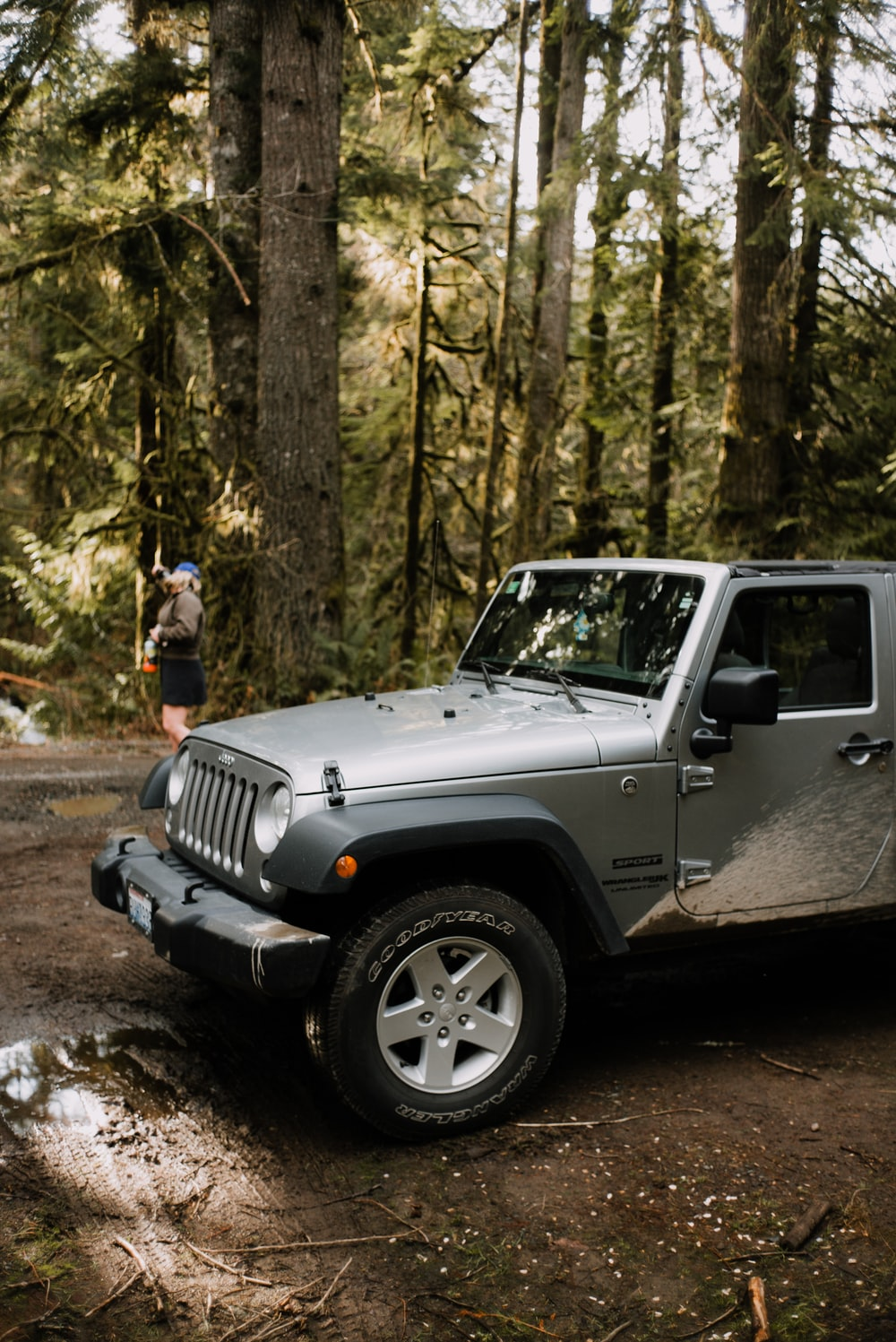 grey jeep wrangler parked near trees during daytime