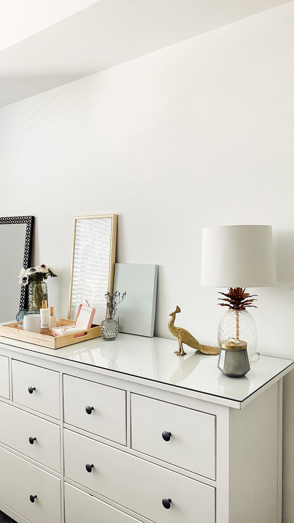white and brown table lamp on white wooden table