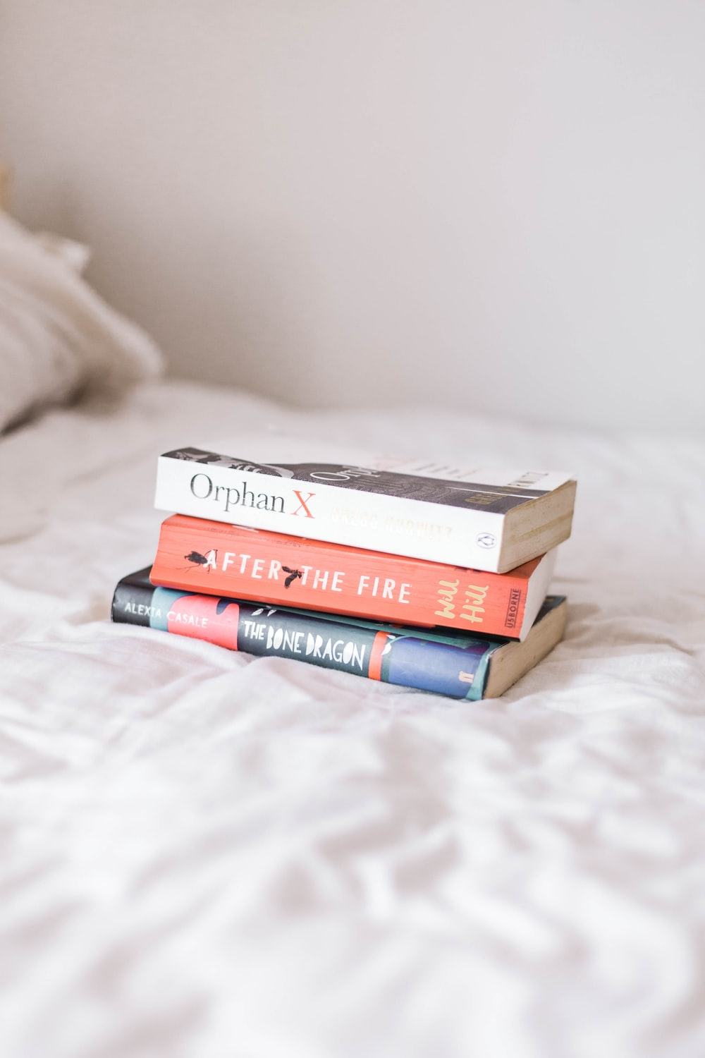 assorted books on white textile