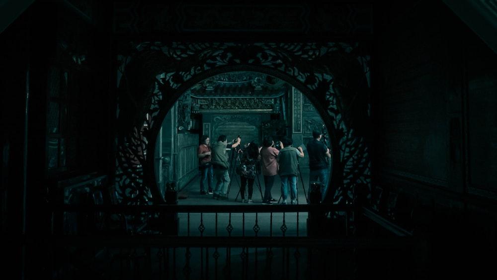2 women standing in front of black metal gate