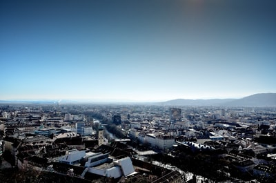 Graz city with high rise buildings under blue sky during daytime
