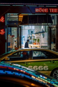 cars parked in front of store during night time
