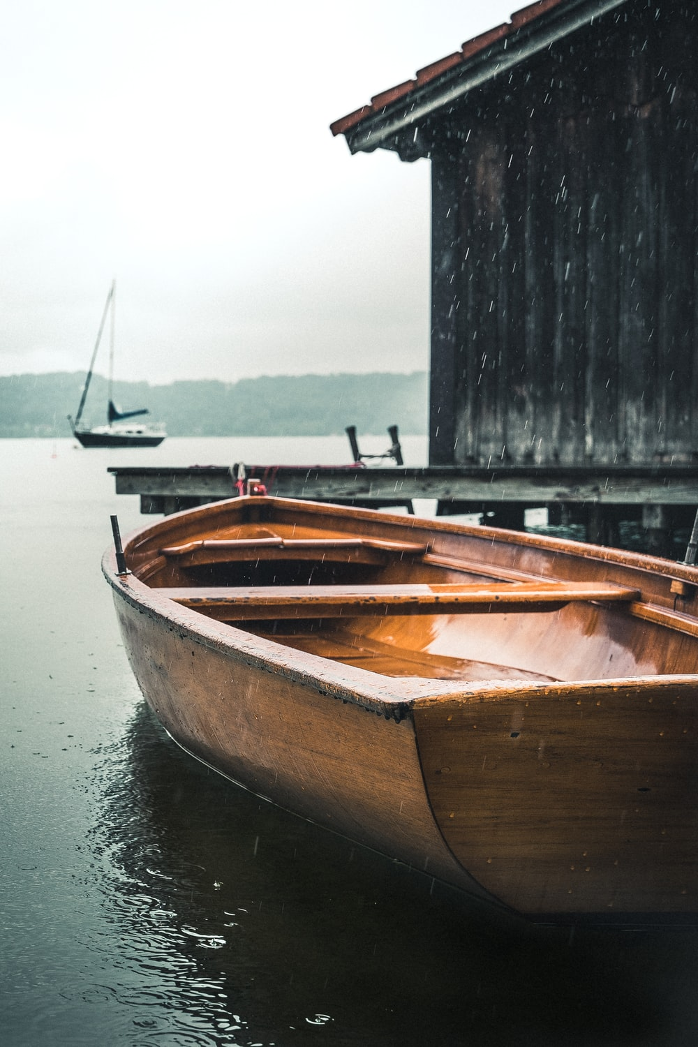 brown wooden boat on water during daytime