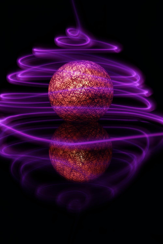 purple and black ball illustration