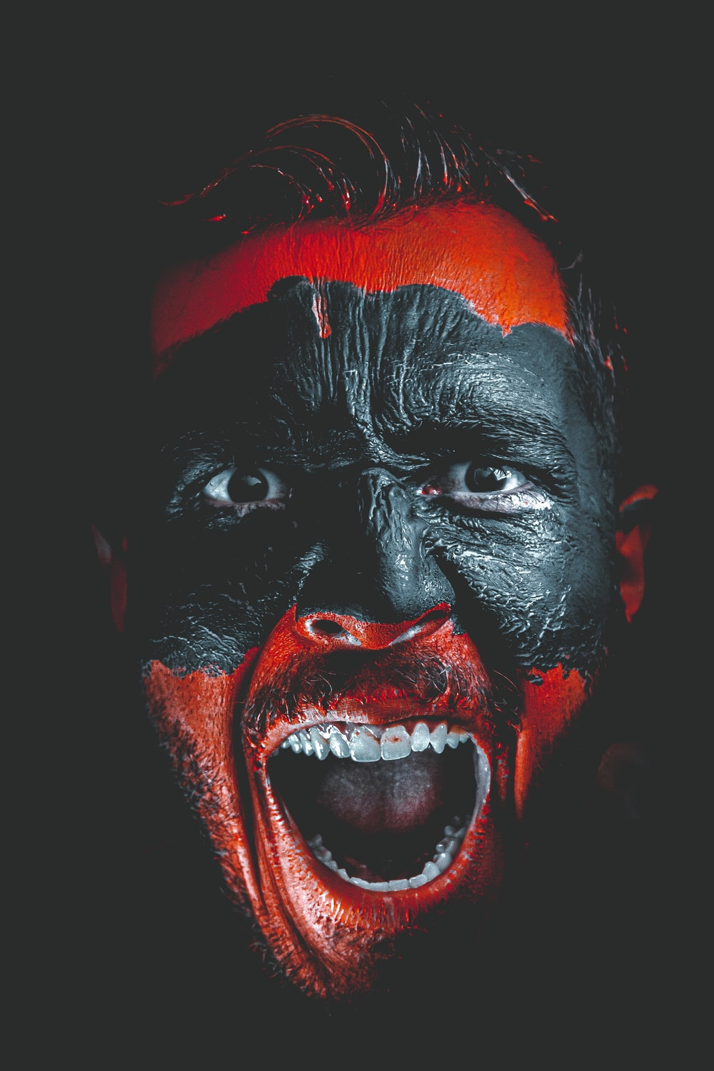 person with red and black face paint