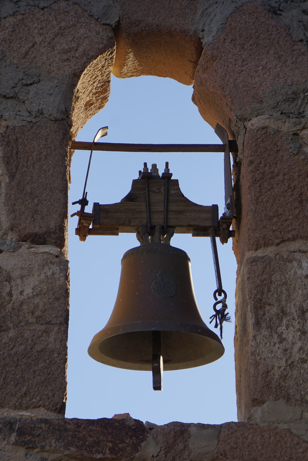 brown bell on brown concrete wall