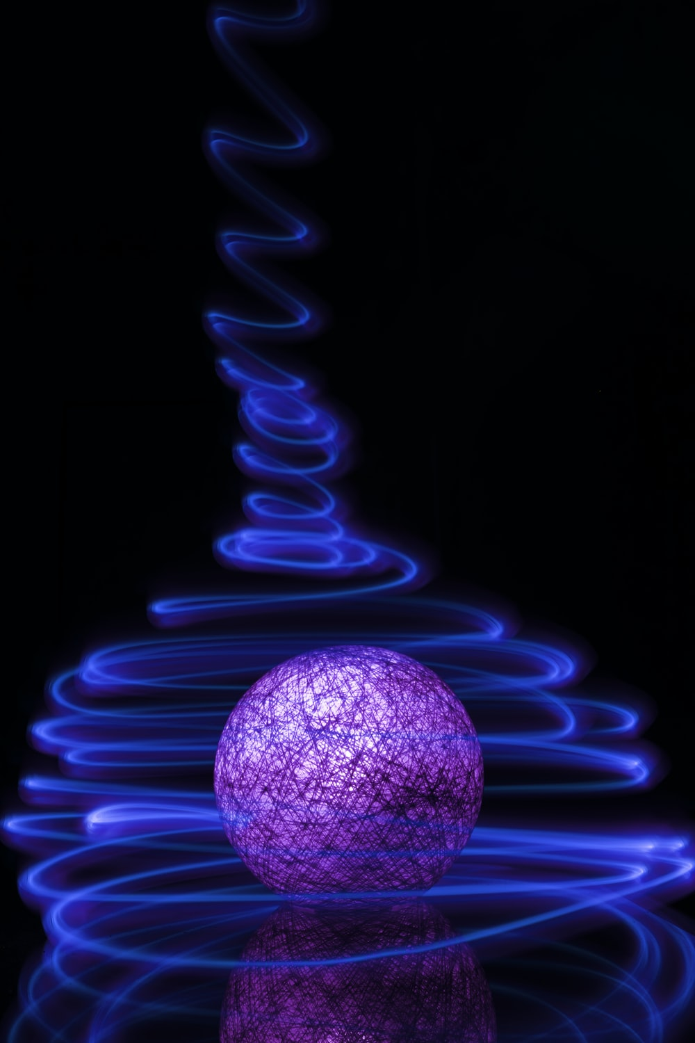purple ball with light in the dark