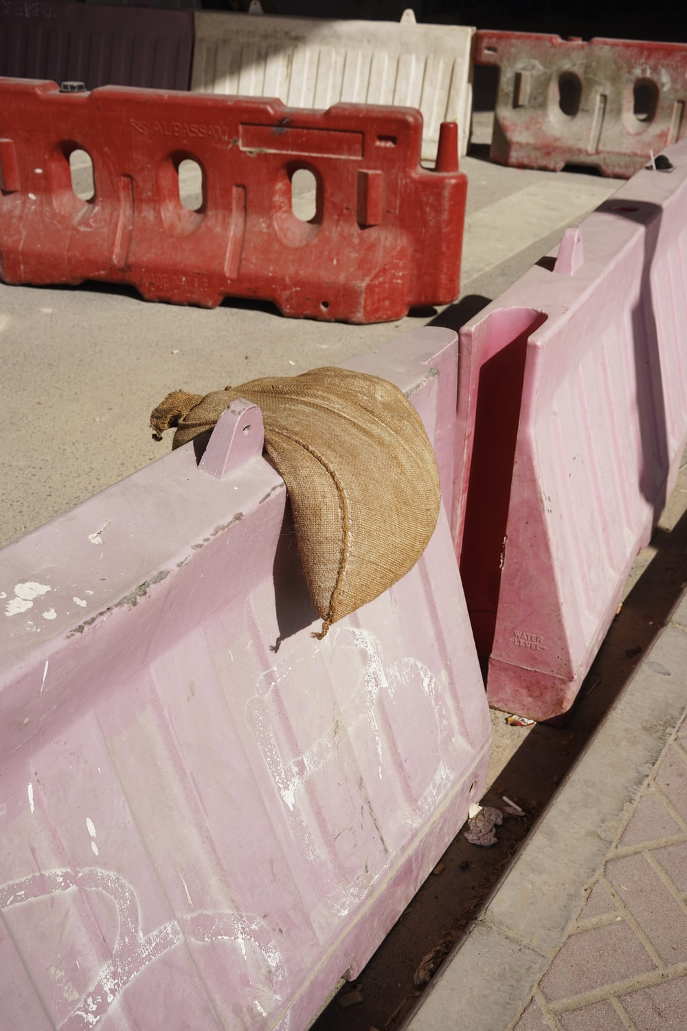 brown straw hat on white and pink wooden table