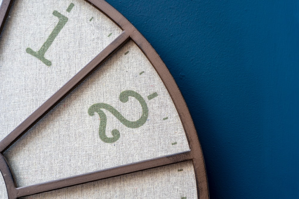 brown wooden analog wall clock