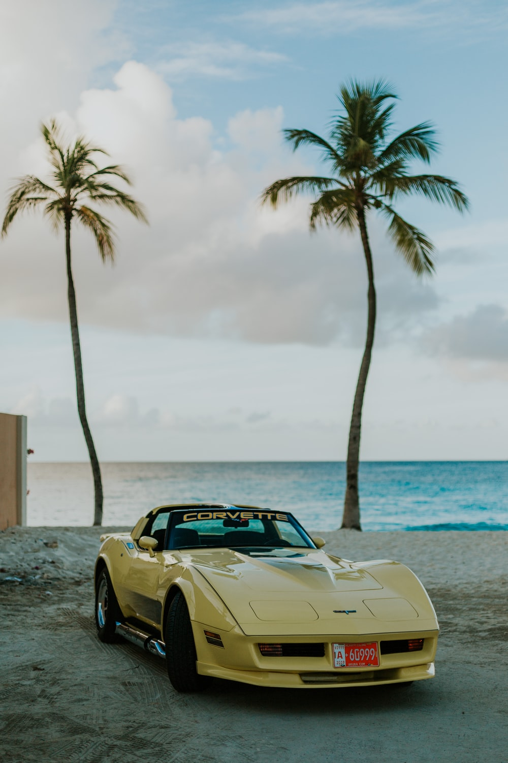 white convertible car parked on beach during daytime