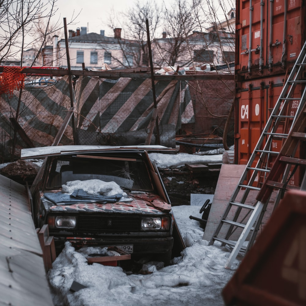 black car parked on snow covered ground