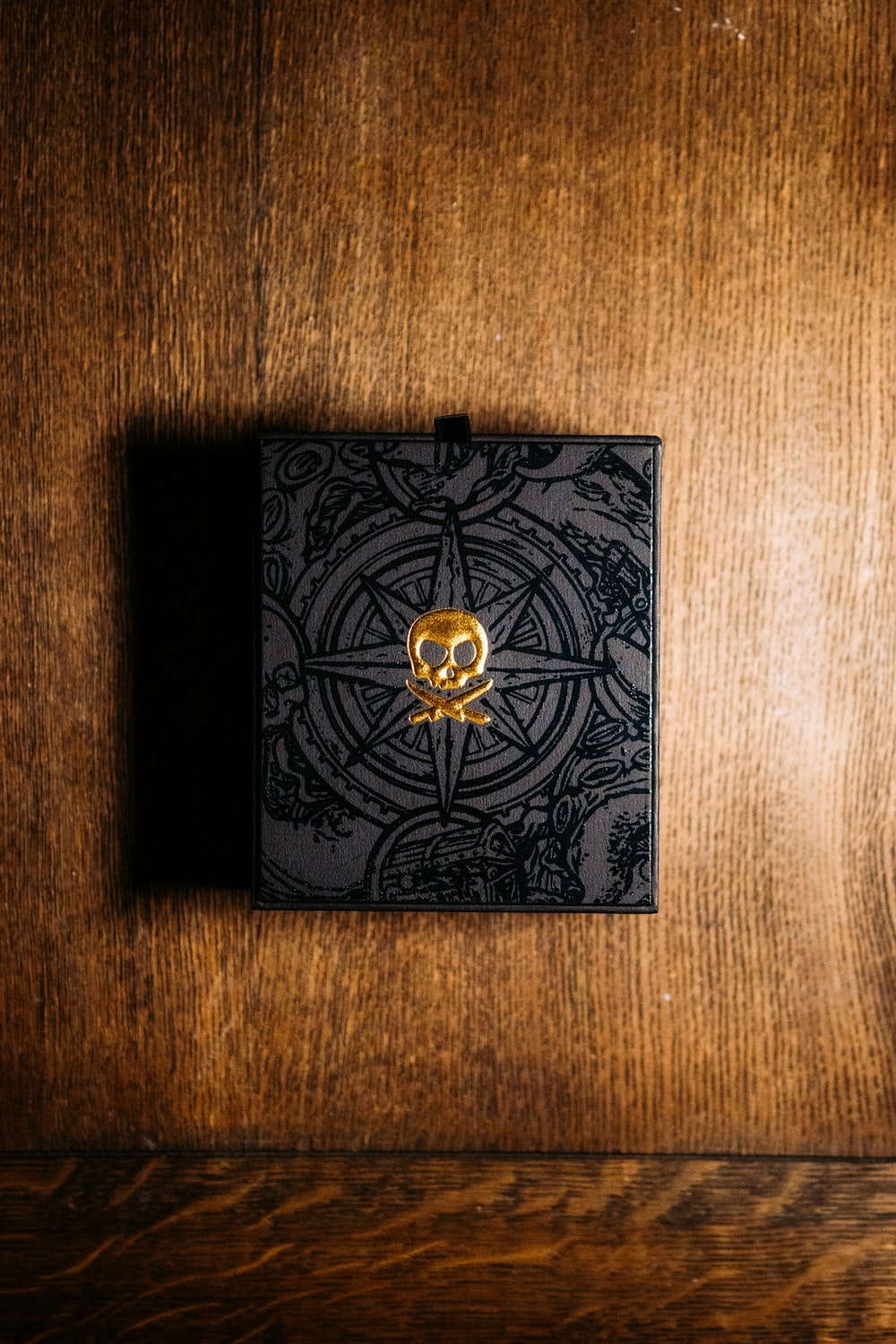 black and gold box on brown wooden table