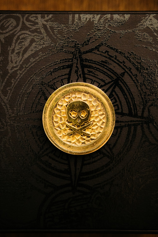 gold round pendant on black textile