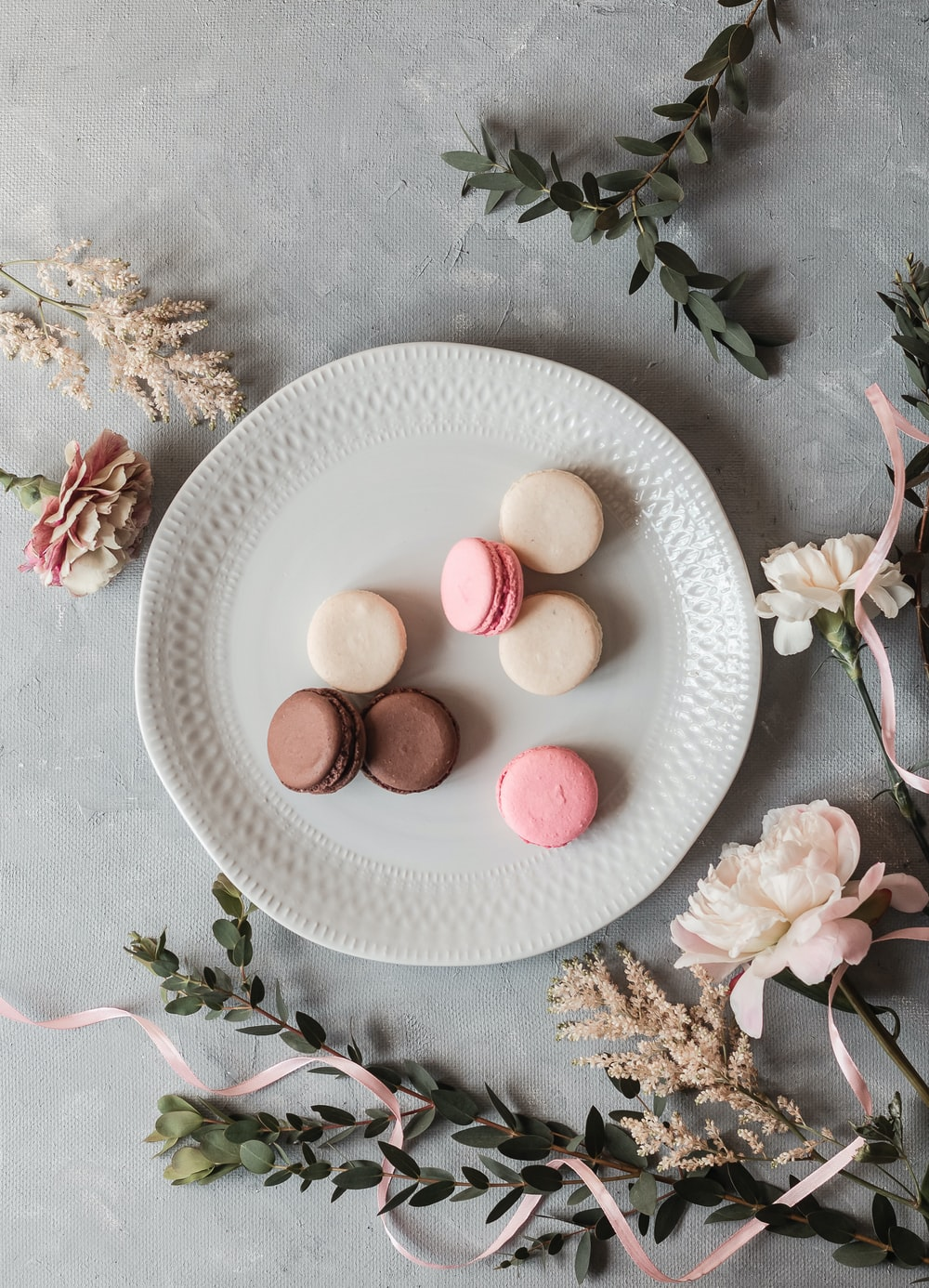 pink and white eggs on white ceramic plate