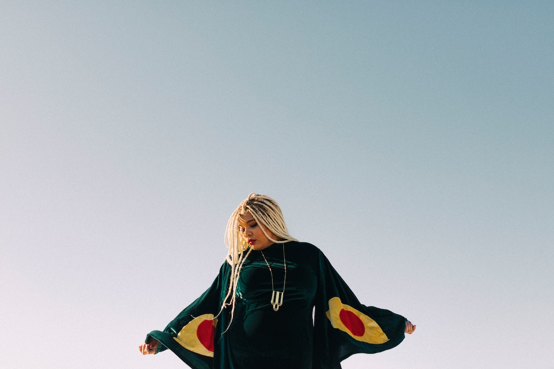 woman in black jacket and green pants