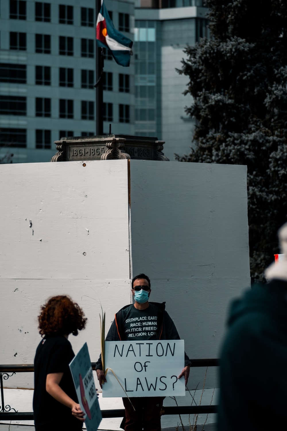 people standing near white concrete building during daytime