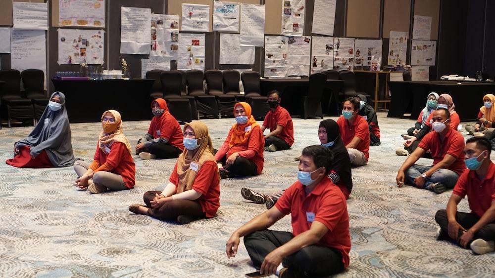 group of people sitting on floor