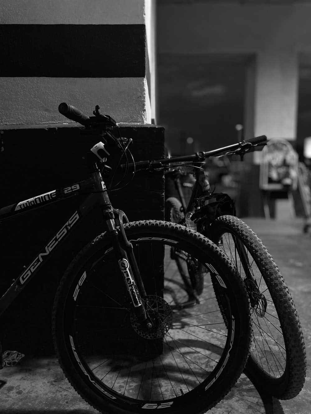 black mountain bike in grayscale photography