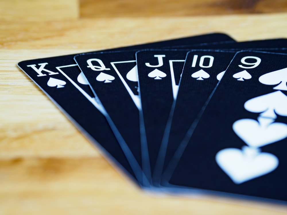 black and white playing cards on brown wooden table