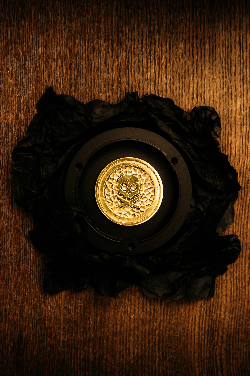 black and gold round wall clock