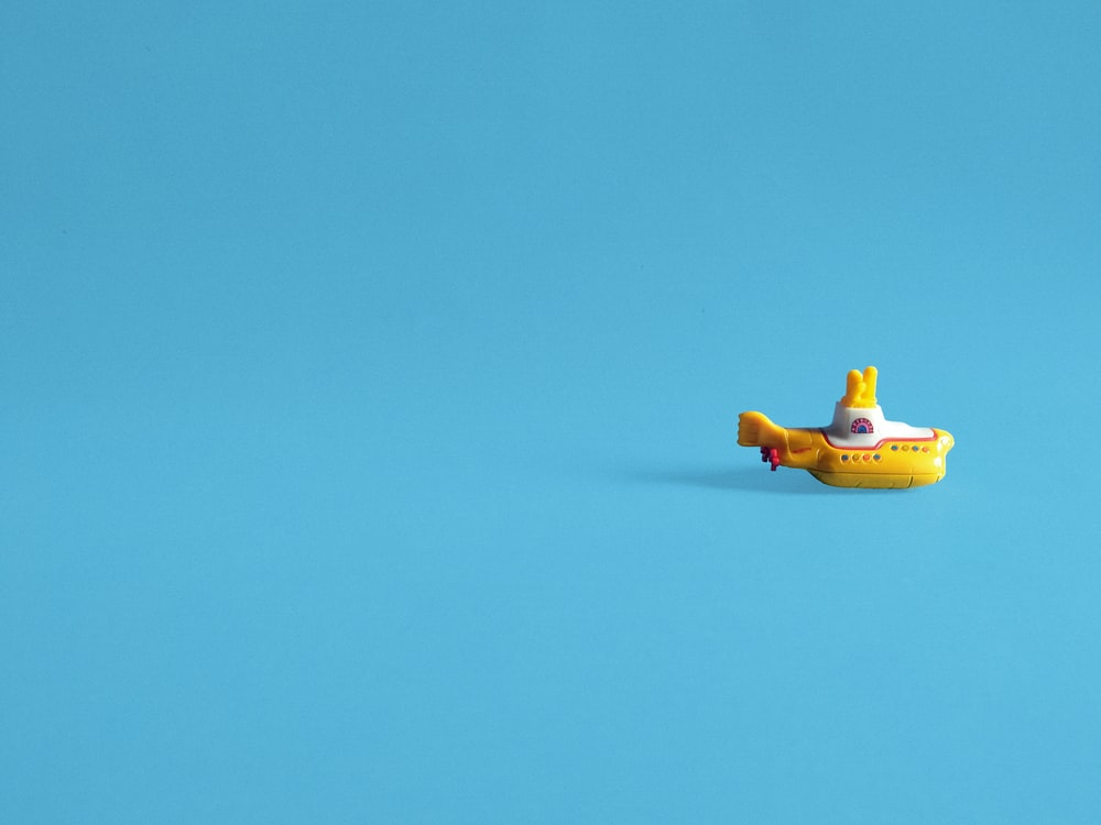 yellow and black plastic toy on blue sky
