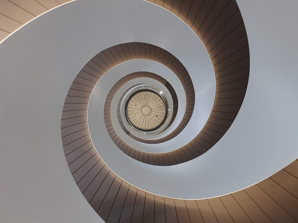 white spiral stairs with white ceiling