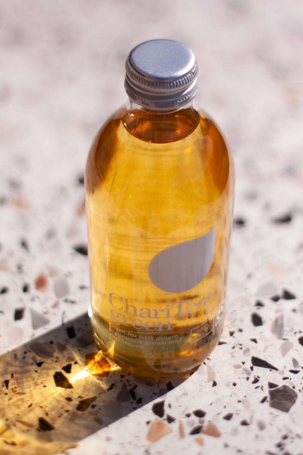 yellow liquid filled clear glass bottle