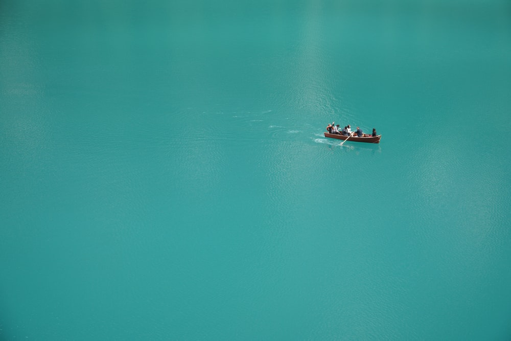 2 people riding on boat on body of water during daytime