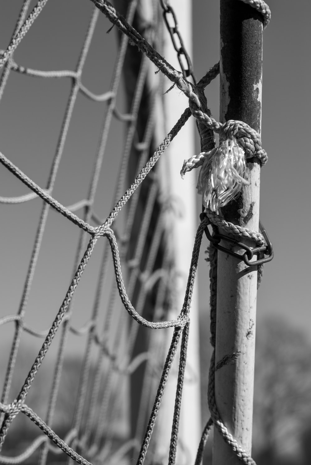 grayscale photo of a rope tied on a wire
