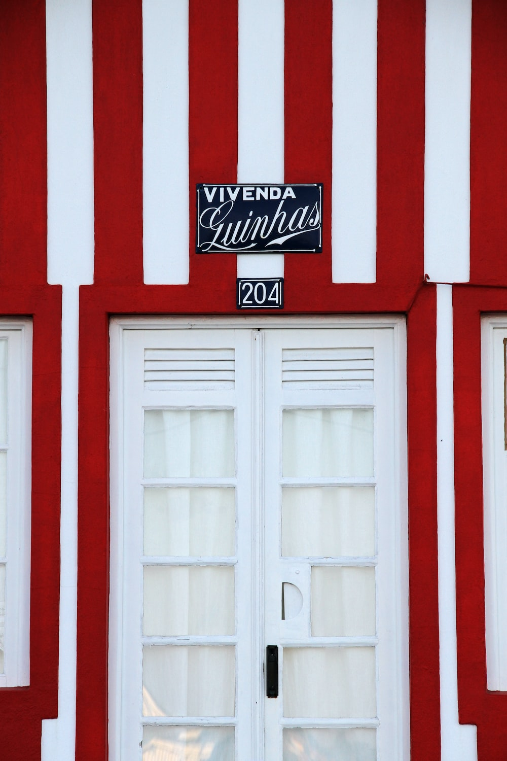 white wooden door with red and white wall