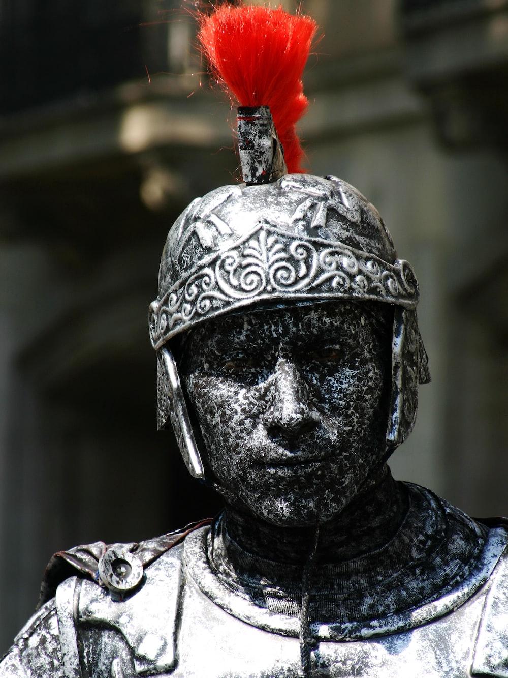man in silver helmet statue