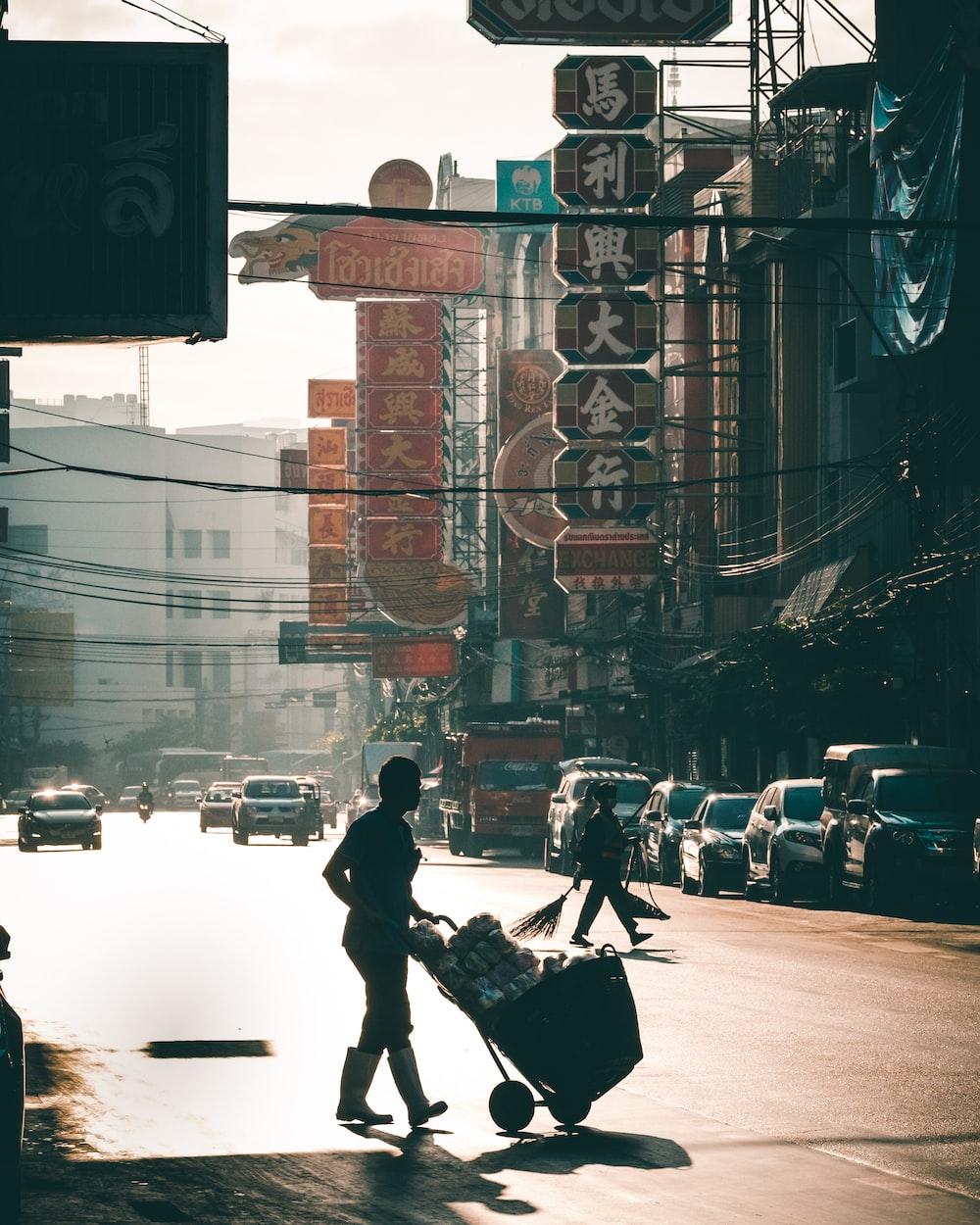 man in black jacket and black pants walking on street during daytime
