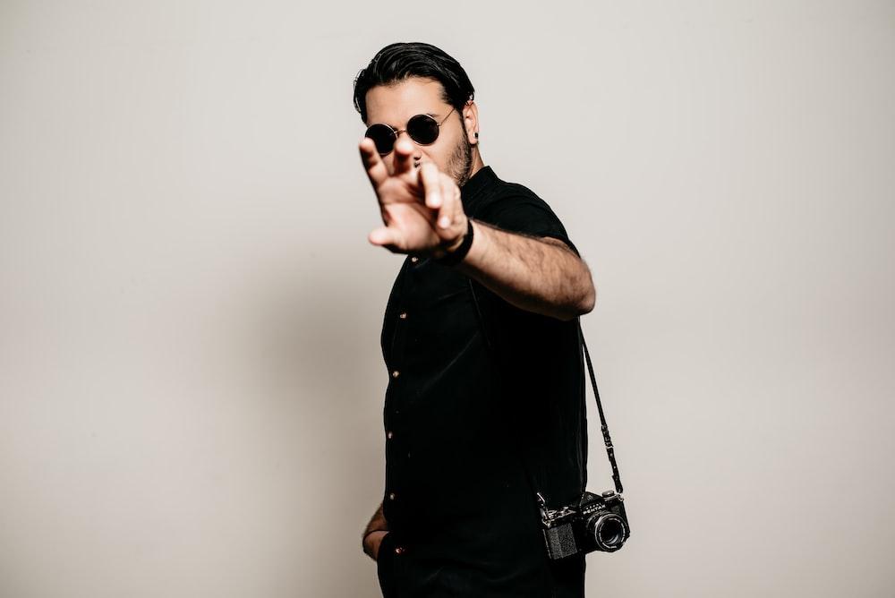 man in black button up shirt wearing black sunglasses