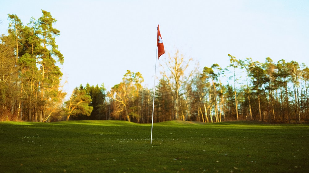 red and yellow flag on pole