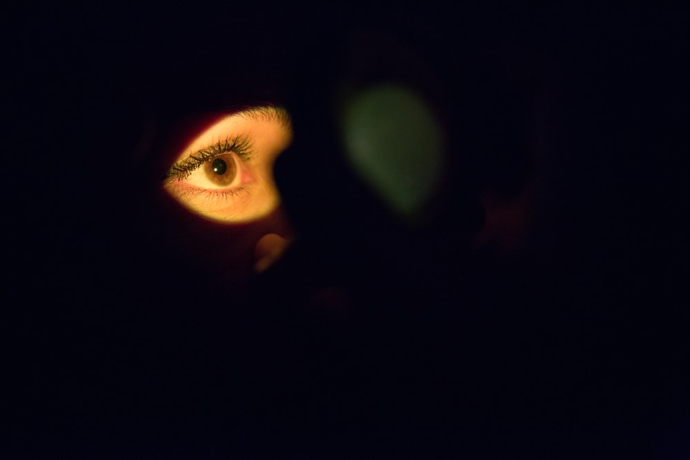 womans face with green eyes