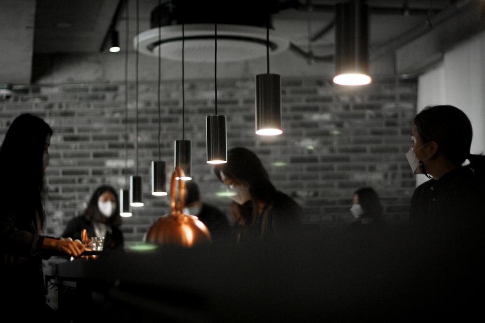 people sitting on chair in front of table with lighted candles