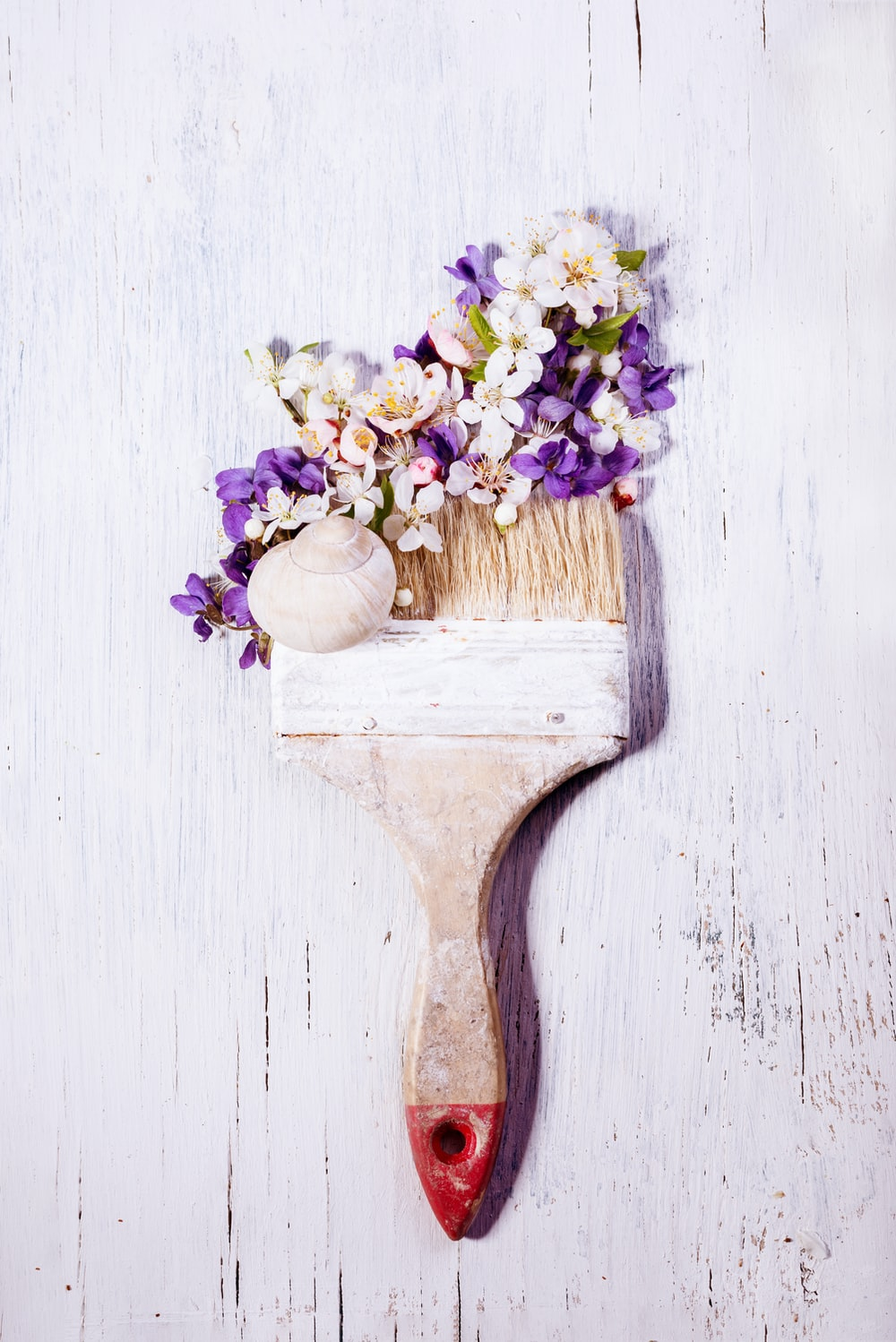 white and brown wooden brush