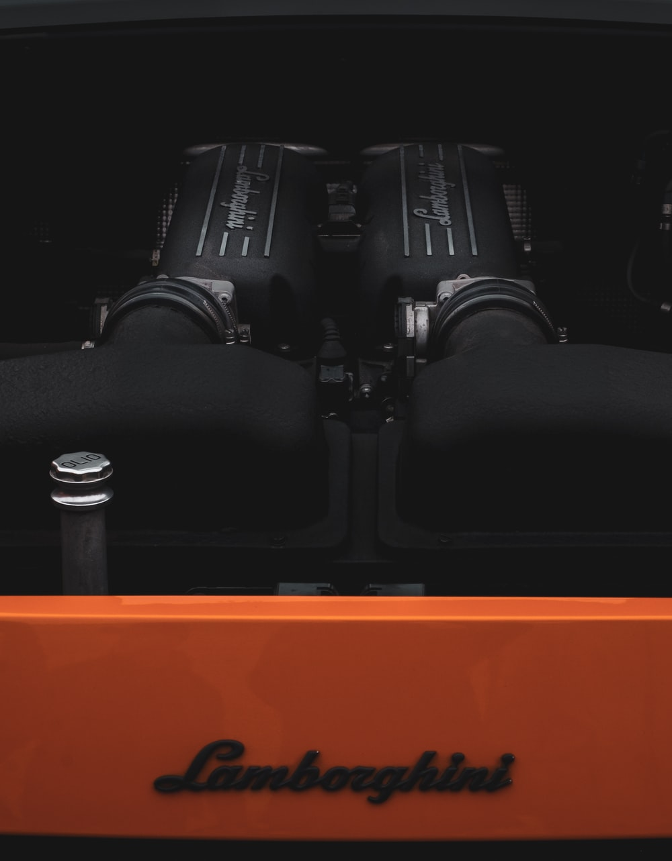 black and orange machine part