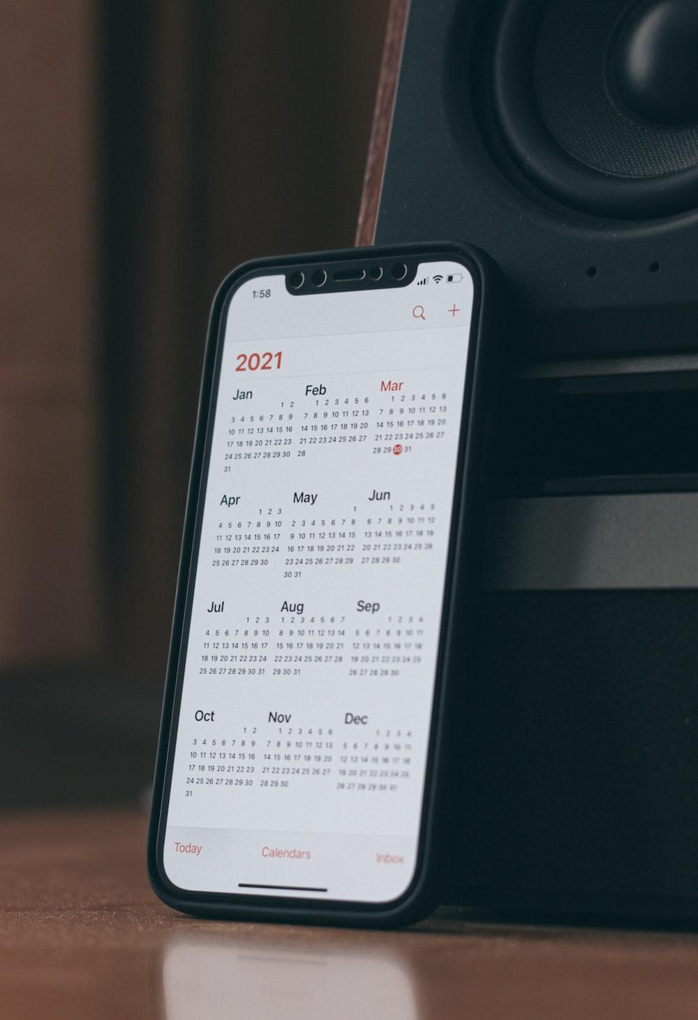white samsung galaxy smartphone on black table