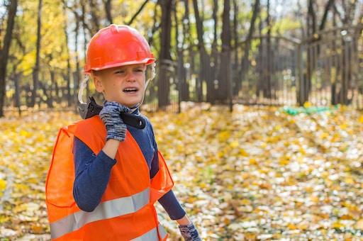 boy in orange helmet and blue and orange jacket