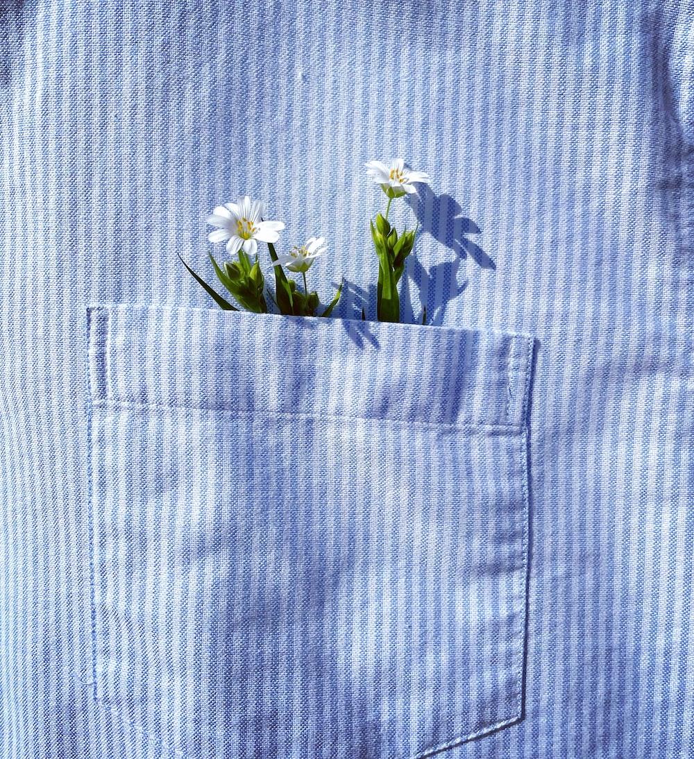 white flower on blue textile