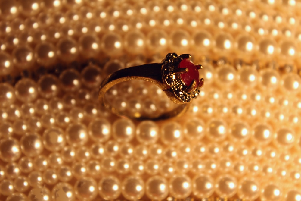silver and red gemstone ring